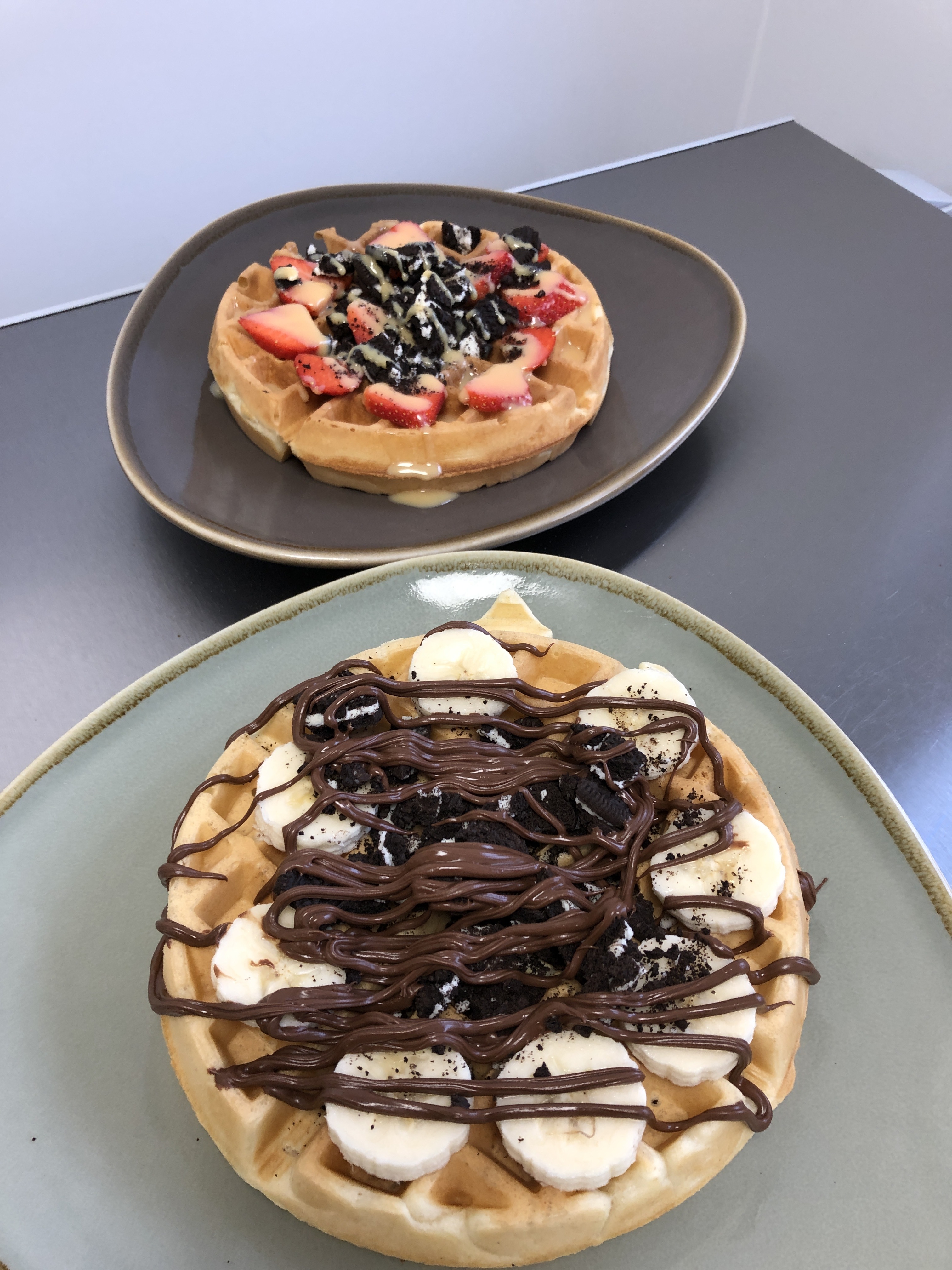 Waffles-topped-with-strawberries-white-chocolate-sauce-crushed-oreos-and-banana-nutella-oreos